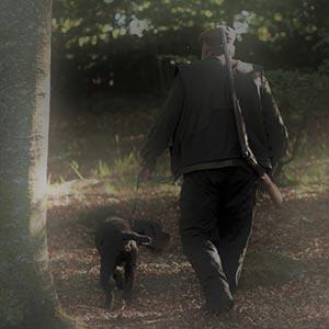 Jägare med hund.